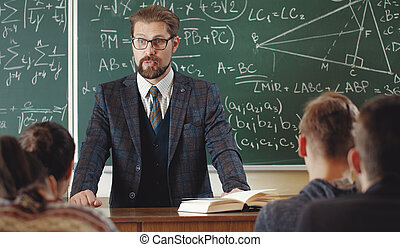 Mathematician with students in classroom - Mathematician in ...