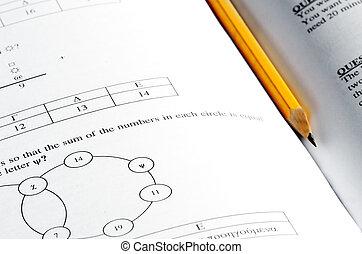 Mathematics exam paper questions and a pencil