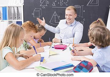 Maths is easy! - Shot of a math teacher having a class with...