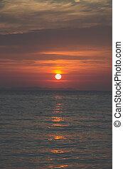 matte blue orange sunset by the sea
