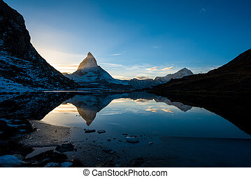 Matterhorn and Dente Blanche from Riffelsee mountain lake above Zermatt, Switzerland