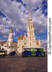 Matthias Church in Budapest city, Hungary. wide view and bus in the frame