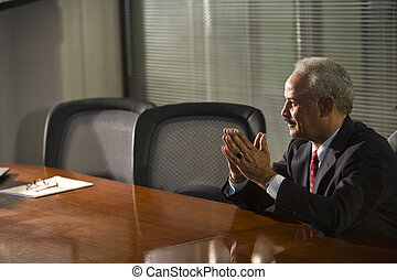 African American businessman sitting at conference table
