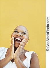 mature african woman smiling for joy