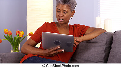 Mature African woman using tablet
