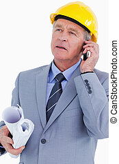 Mature architect on his mobile phone