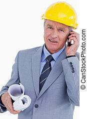 Mature architect talking on his cellphone