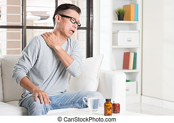 Mature Asian man shoulder pain