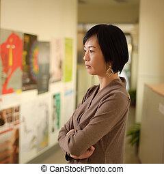 Mature Asian woman thinking
