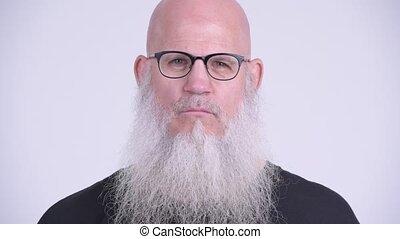 Mature bald bearded man doing three wise monkeys concept -...