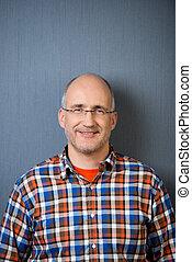 Mature balding man with a friendly smile - Portrait of a...