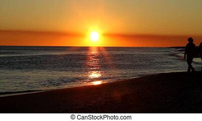 Mature Beach Sunset Walk
