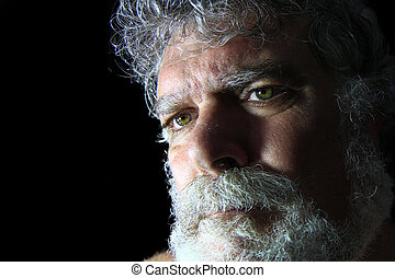 Mature bearded man with angry face