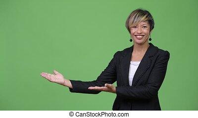 Mature beautiful multi-ethnic businesswoman showing...