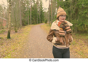Mature beautiful woman getting away from it all with nature...