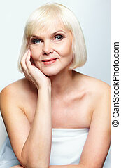 Mature beauty - Mature lady looking at camera with smile