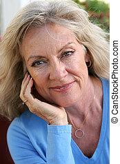 Mature Beauty - Relaxed - A beautiful, mature blond woman ...