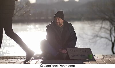 Mature beggar asking for money help on street - Mature...