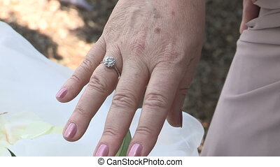 Mature bride shows her wedding ring