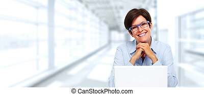 Mature business lady with laptop.