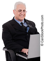 Mature business man in working with laptop