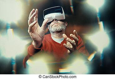Mature business man wearing virtual reality googles / VR...