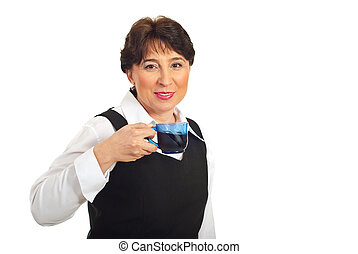 Mature business woman drinking coffee