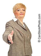 Mature business woman give handshake