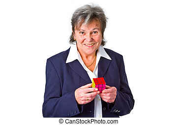 Mature business woman holding a Cube