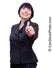Mature business woman showing thumbs up, OK sign smiling happy.