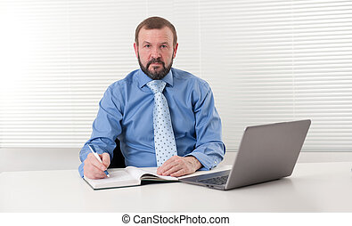 mature businessman at his office