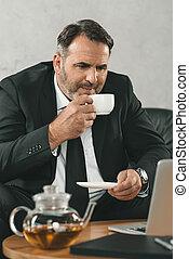 businessman drinking tea