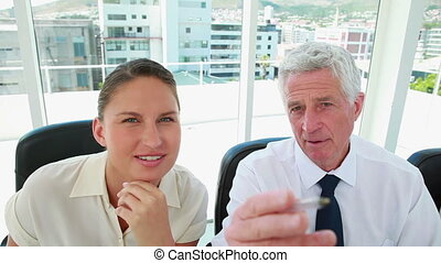 Mature businessman explaining something to a young woman