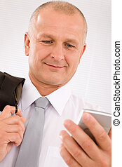 Mature businessman hold phone close-up portrait