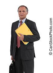 Mature businessman holding a folder