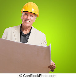 Mature Businessman Holding Blueprint
