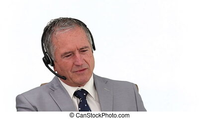 Mature businessman in gray suit talking on a phone