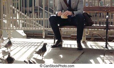 Mature businessman on a train station. - Unrecognizable...