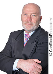 mature businessman posing against white