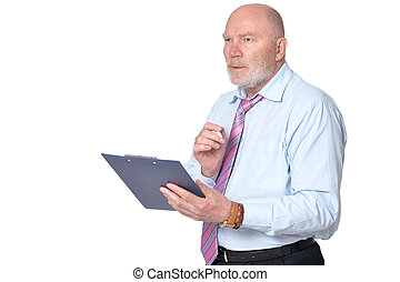 mature businessman posing against white