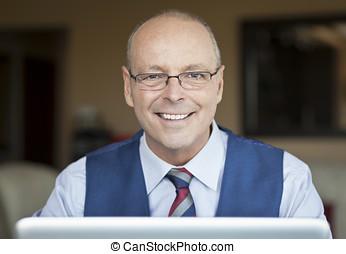 Mature Businessman Smiling - Office Interior, Home Interior,...