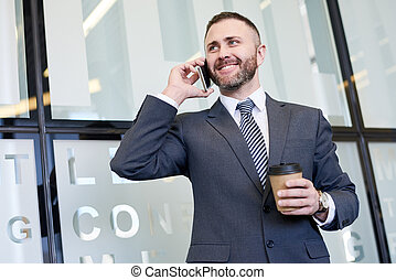 Mature Businessman Speaking by Phone