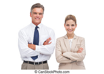 Mature businessman standing with his coworker