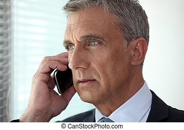 mature businessman talking on his cell
