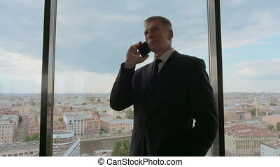 Mature businessman talking on mobile phone