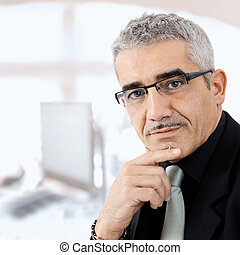 Mature businessman thinking - Mature gray haired creative ...