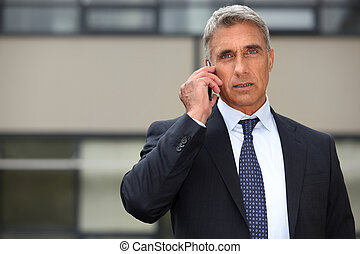 Mature businessman using a cell phone