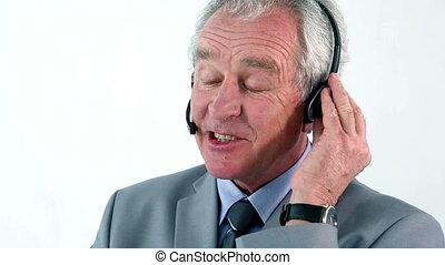 Mature businessman using a headset