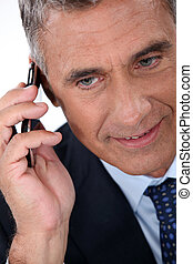 Mature businessman with a cellphone
