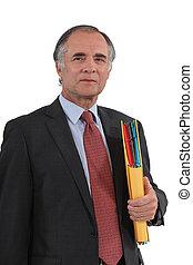 Mature businessman with a folder